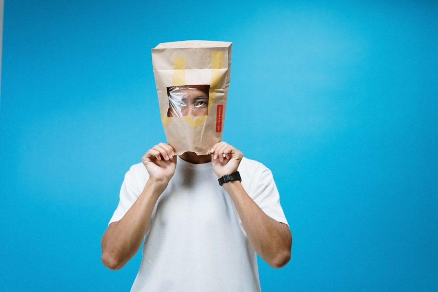 A-man-wearing-a-takeaway-bag-on-his-head-in-a-mock-HAZMAT-style